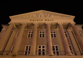 Facade at night of the Danish Bank in Copenhagen with big columns in Ionic order and a decorated pediment, Copenhagen, october 14, 2018