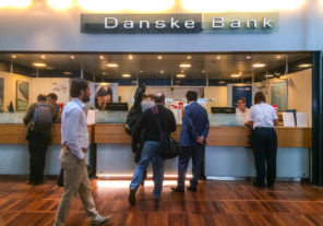 Copenhagen, Denmark  - September 15, 2014: Danske Bank at Copenhagen airport, Denmark, people talking to bank workers.