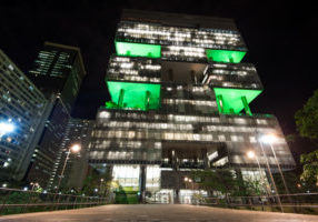 Rio de Janeiro, Brazil - April 17, 2018: Facade of Petrobras company building at night with green decorative lights.